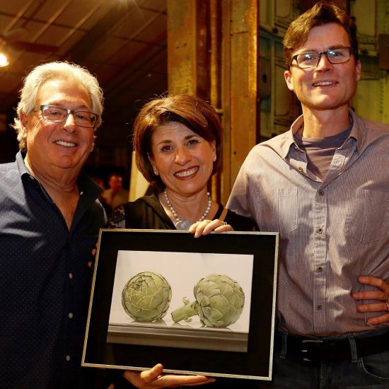 2016 Commissioners Steve Rodgveller and Brenna Lacy with their painting of artichokes by artist Ben Johnson.